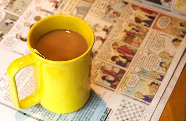 coffee mug and Sunday funnies